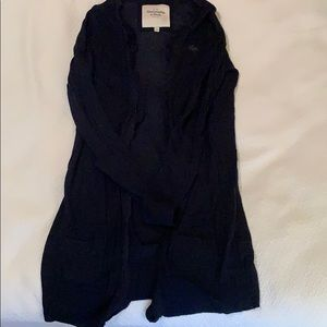 this is a black thin cardigan sweater